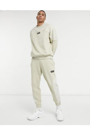 ASOS ASOS Unrvlld Spply co-ord tapered trackies in beige with nylon colour-block panels-Neutral