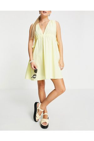 ASOS Cotton poplin plunge mini sundress with ruched waist in yellow