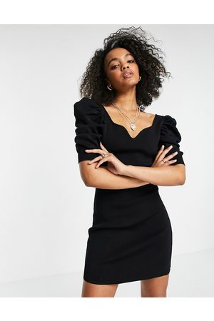 Morgan Knitted sweetheart neck puff-sleeved midi dress in black