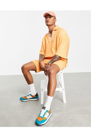 ASOS Outfit Sets - Co-ord oversized short sleeve sweatshirt with pocket in orange