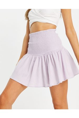 ASOS Mini skirt with shirred waist in lilac-Purple
