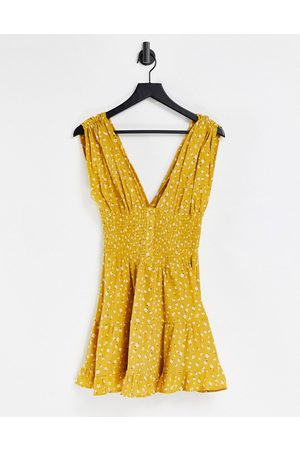 ASOS Shirred waist button front tiered mini sundress in crinkle in mustard floral print-Multi