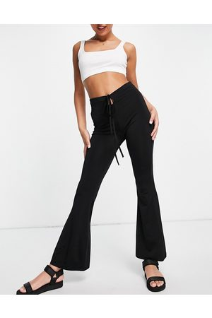 Pimkie Jersey flares with keyhole and wrap around tie detail in black
