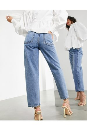 ASOS Tapered jean with twisted seam in mid wash-Blue