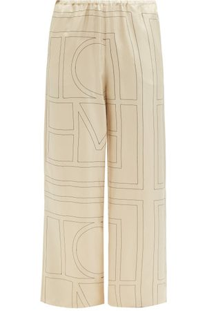Totême Women Pyjamas - Monogram-embroidered Silk-twill Pyjama Trousers - Womens - Cream