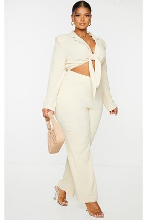 PRETTYLITTLETHING Plus Stone Padded Shoulder Cut Out Tie Front Jumpsuit