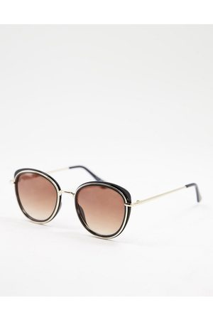 Jeepers Peepers Women's round sunglasses in black