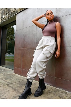 Public Desire X Amber Gill pocket detail cuffed cargo pants in taupe-Neutral
