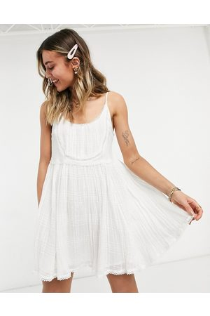 ASOS Mini cami smock sundress with pintucks and crochet lace in white