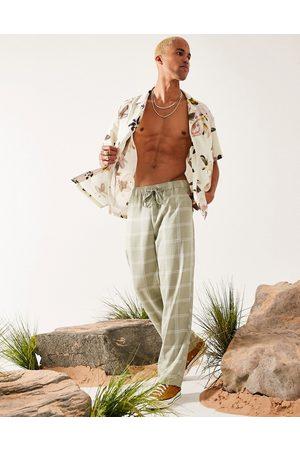 ASOS DESIGN Linen-mix wide-legged pants in green check