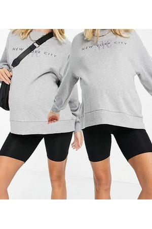 ASOS ASOS DESIGN Maternity 2 pack over the bump basic legging shorts in black