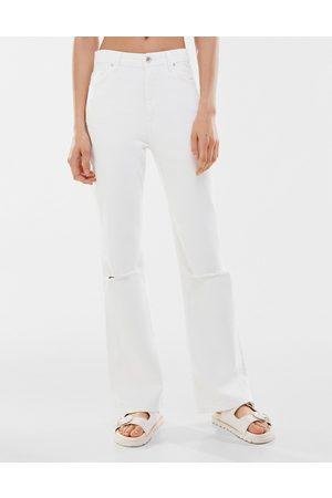Bershka Ripped stretch flare jeans in white
