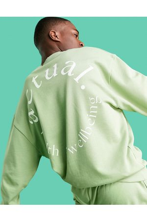 ASOS Athleisure oversized sweatshirt in green with health and wellbeing logo largeback print