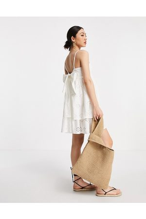 ASOS Bandeau double layer tie-back mini sundress in broderie in white