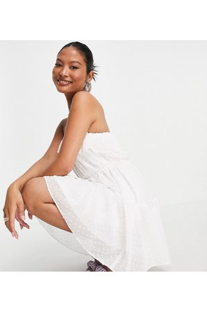 ASOS ASOS DESIGN Petite ruffle bandeau mini skater dress with belt in dobby in ivory-White