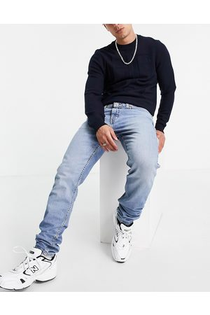 Levi's 512 slim tapered fit lo-ball jeans in mid wash blue