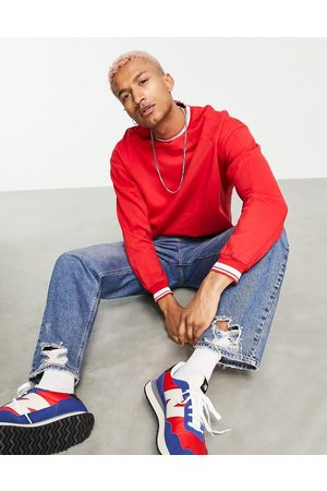 ASOS Oversized sweatshirt with tipping and panel detail in red