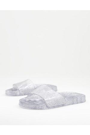 Juju Jelly flat slides in clear silver glitter