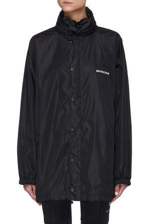Balenciaga Women Raincoats - Logo Print Nylon Rain Jacket