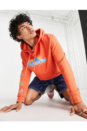 ASOS ASOS Daysocial relaxed hoodie with multi placement logo prints in orange