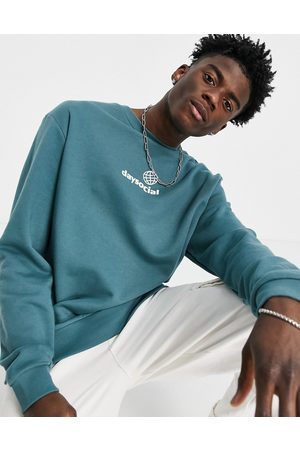 ASOS ASOS Daysocial relaxed sweatshirt in blue with white small chest logo print
