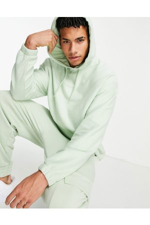 ASOS Oversized polar fleece hoodie in light green with logo