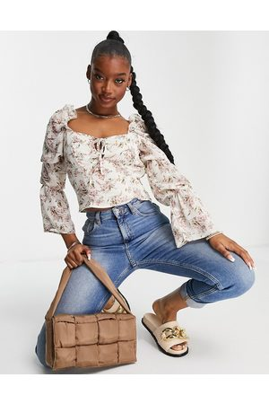 Missguided Tie neck blouse with frill shoulder in floral-White