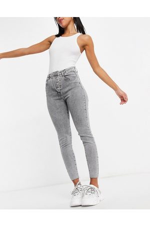 Missguided Asymmetric button jeans in -Blue