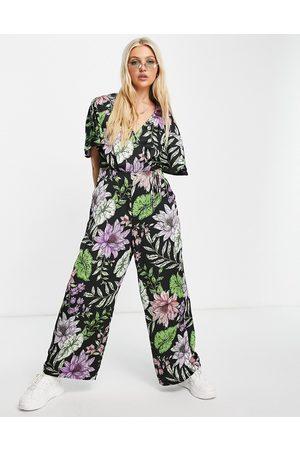 Liquorish Wrap jumpsuit in tropical flower print-Multi