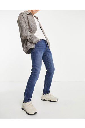 Topman Organic cotton blend stretch slim jeans in mid wash