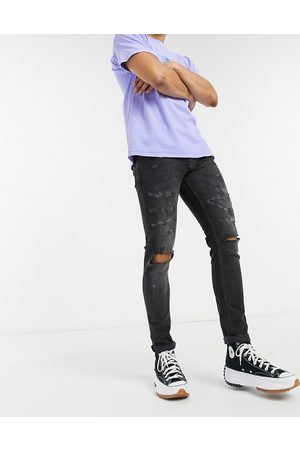 Topman Organic cotton blend stretch skinny jeans with rips in
