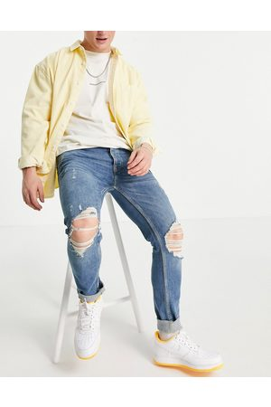 Topman Organic cotton blend stretch skinny jeans with rips in -Blue
