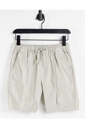 ASOS Slim chino shorts with pintuck and elasticated waist in beige-Neutral
