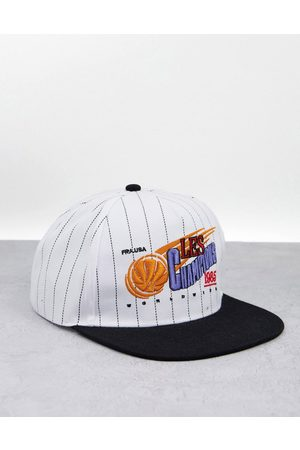 ASOS Snapback cap in stripe with retro les champions embroidery