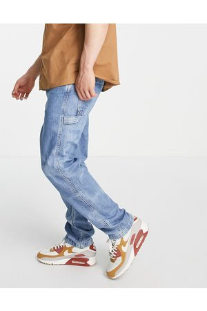 Levi's Tapered fit carpenter jeans in mid wash blue