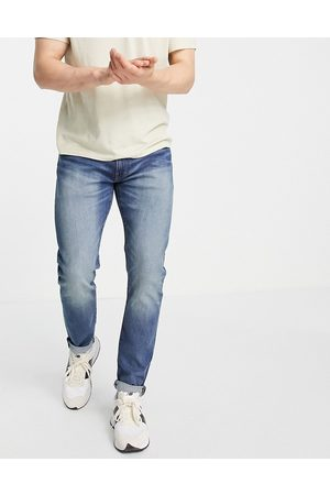 Levi's 512 slim tapered fit jeans in navy vintage wash