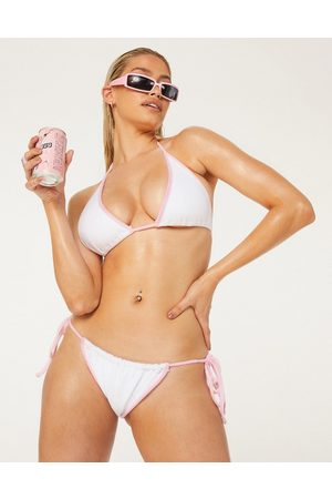 New Girl Order Exclusive terry towelling tie-side bikini bottom in white with pink bind