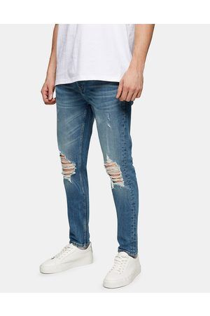 Topman Men Skinny - Organic cotton blend stretch skinny ripped jeans in mid wash