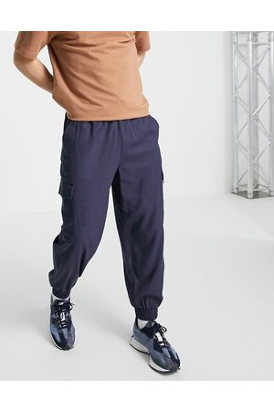 ASOS Linen mix oversized tapered pants with cargo pockets in