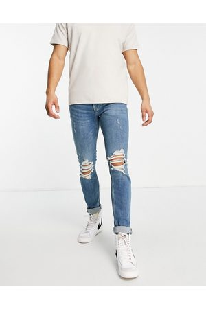 Topman Organic cotton blend stretch skinny ripped jeans in mid wash
