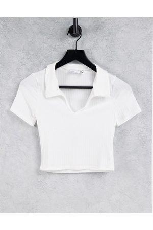 ASOS Fitted polo top in rib with short sleeve in
