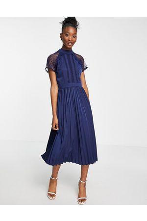 Liquorish Al-ine lace detail midi dress with pleated skirt in