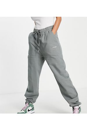 COLLUSION Unisex trackies with logo print in -Green