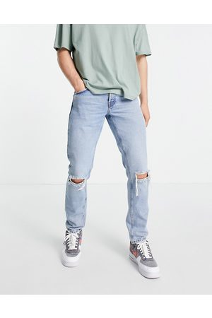 ASOS Organic cotton blend slim jeans in 90s stone wash with knee rips-Blue