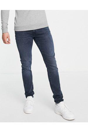 Levi's Skinny tapered fit jeans in dark navy overdye