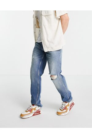 ASOS Original fit jeans in tinted mid wash blue with knee rip and destroyed hem
