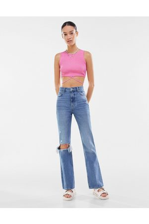 Bershka Women Bootcut & Flares - Ripped stretch flare jeans in