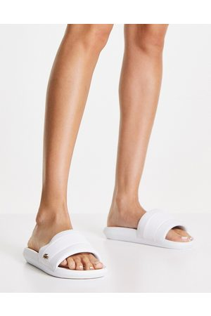Lacoste Women Thongs - Croco pin slide in white and gold