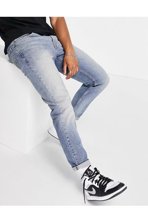 Levi's Men Tapered - 502 tapered fit hi-ball jeans in mid blue vintage wash
