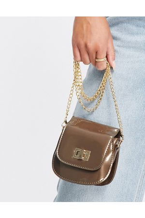 Truffle Collection Women Shoulder Bags - Micro mini patent curved cross body in